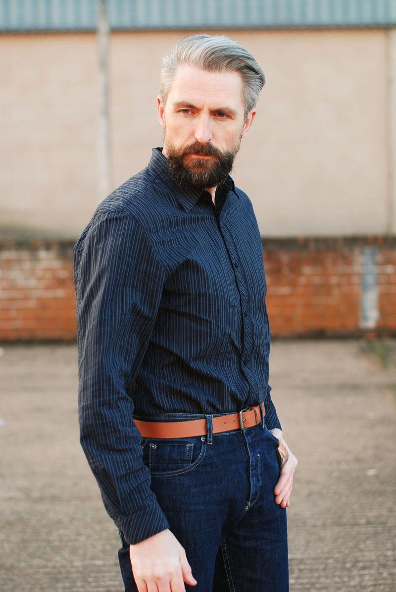 Menswear: Dark striped shirt, jeans and tan belt