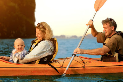 A family kayaking in Halong