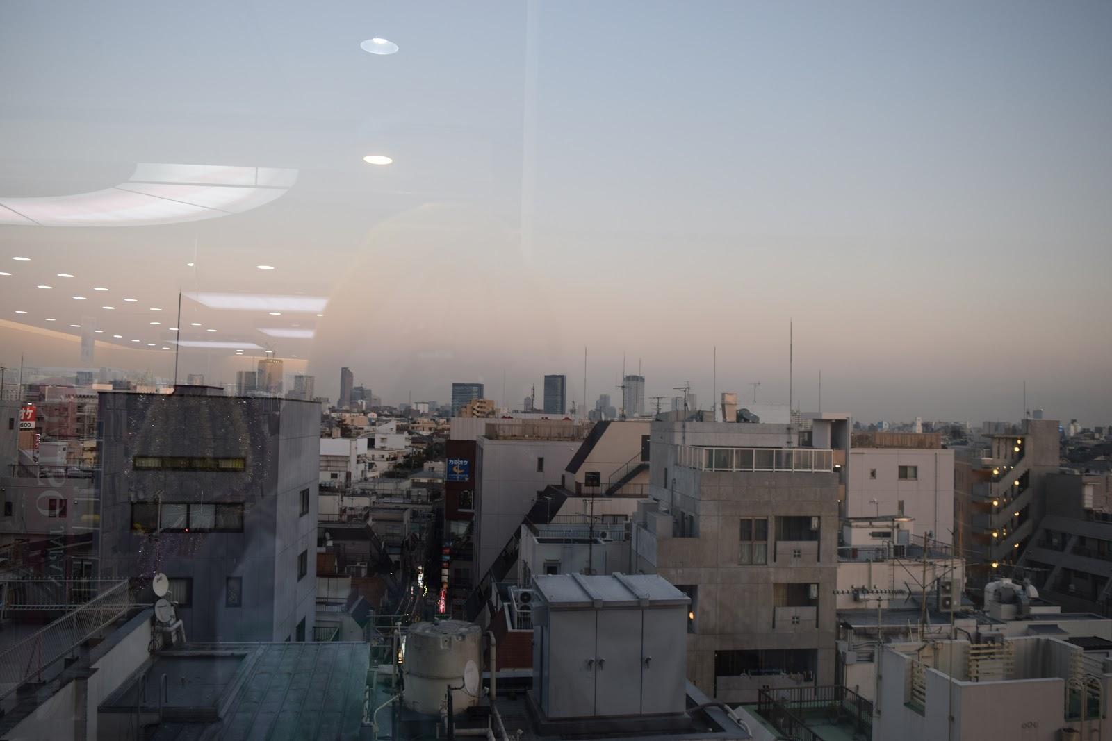 Tokyo skyline as seen from the window of Daiso in Shimokitazawa