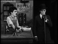 """Кадр из к/ф Чарли Чаплина """"Солнечная сторона"""" / Sunnyside (1919) - 19"""