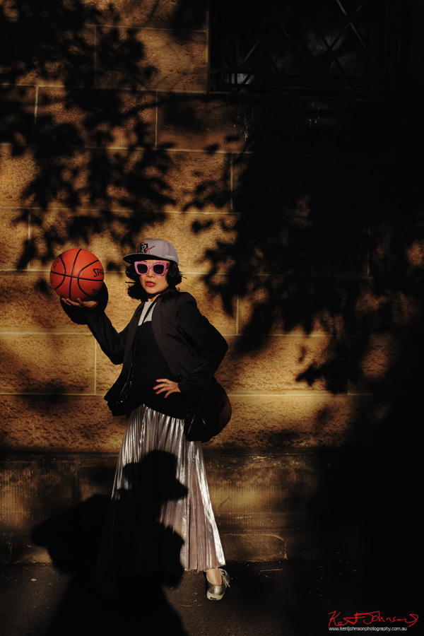 White Caviar Life's Vivienne Shui modelling in late afternoon light, sandstone and shadows -  for an impromptu street-basketball fashion shoot after the TISSOT NBA Finals Party Sydney - Photography by Kent Johnson.