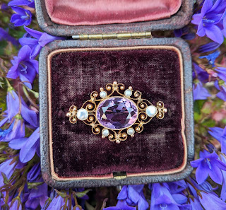 picture of a vintage brooch with a purple gem stone - Typecast : 4 Reasons Why It's Better to Buy Vintage
