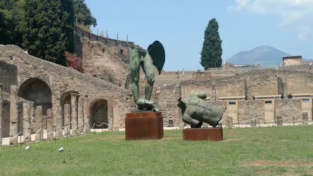 Pompeii courtyard- statues added and worn down for effect by the Italian board of tourism