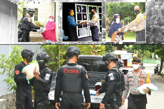 Tim Puma Polres Lotim Bersama Bhabinkamtibmas Distribusi Bantuan Beras