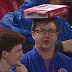 Cubs fan uses pizza box to shield himself from rain (Video)