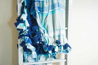 blue and white fleece blanket.