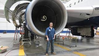 Jp Wuethrich infront of an A340 engine