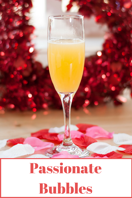 Passionate Bubbles is a fun bubbly Valentine's Day cocktail that mixes champagne and passion fruit puree.