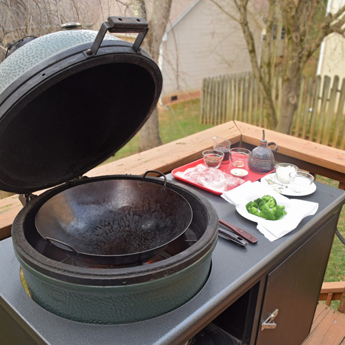 Large Big Green Egg kamado grill in a Challenger Designs Torch grill cart.