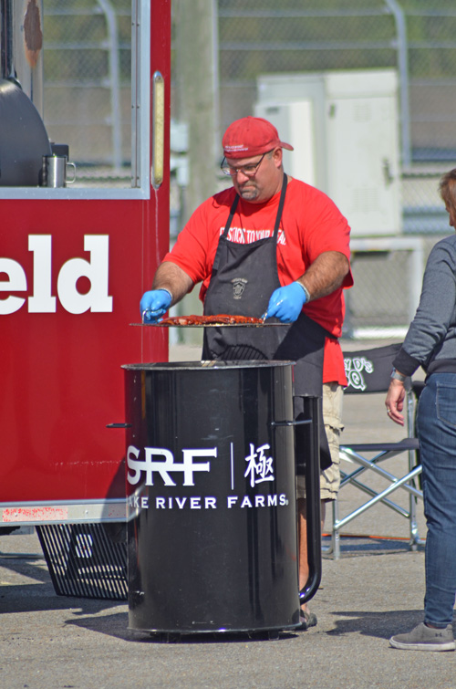 Iowa Smokey D's putting his Smithfield pork ribs in the smoker to finish on the final day at the 2019 Smokin' with Smithfield National Barbecue Championship