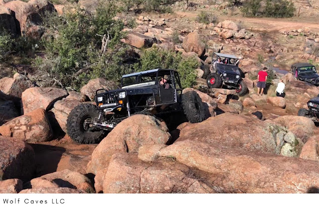 modified TJ Jeep crawling up a rocky trail