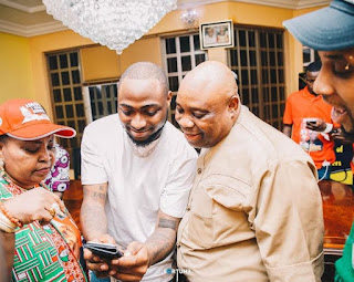 Davido and his uncle, Senator Ademola Adelekeb