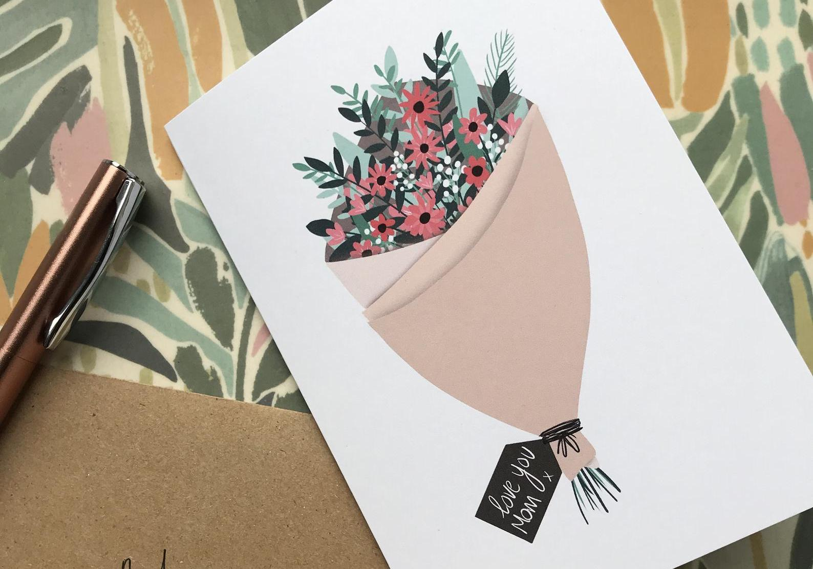 "A mothers day card showing a hand drawn bouquet with the word ""mom"" on the gift tag"
