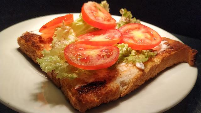 Lettuce leaves tomato slice over toasted Bread Food Recipe Dinner ideas