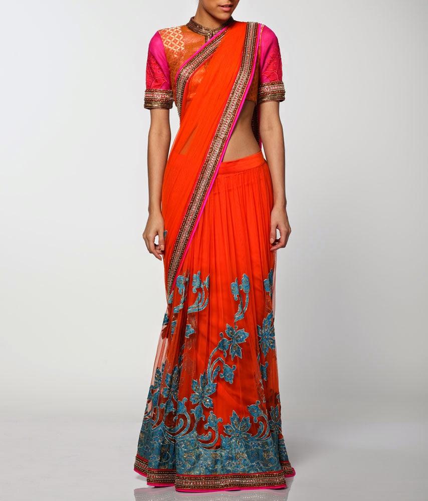 7e43359551b4 A splendid orange net saree lehenga embellished with blue kanjivaram  appliqué on the lehenga and pallu. The saree sports a kundan and beadwork  border and ...