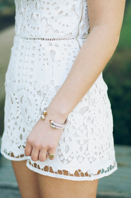 david yurman bracelets with gold signet ring and white lace romper