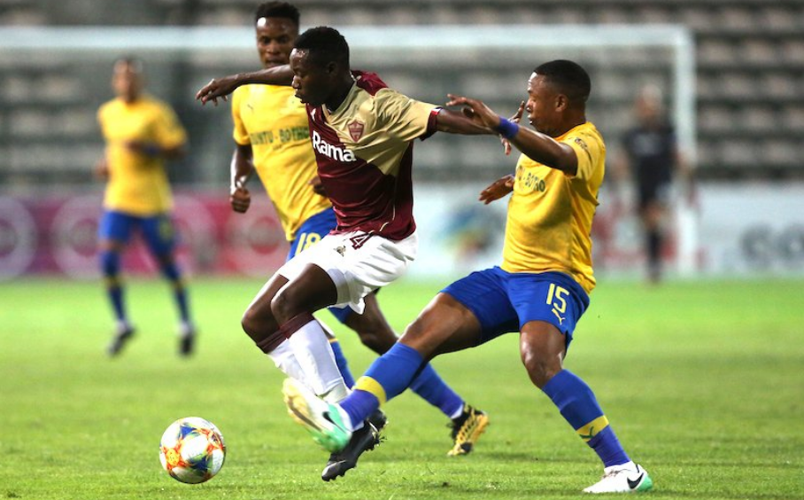 18-year old midfielder Msengi battling Andile Jali for the ball on debut
