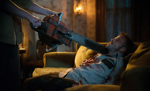 Sheriff Hal Hartman (Stephen Dorff) encounters Leatherface in LEATHERFACE (2017)