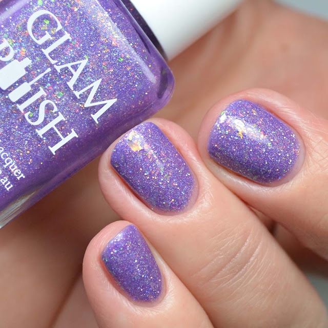 purple nail polish with flakies swatched