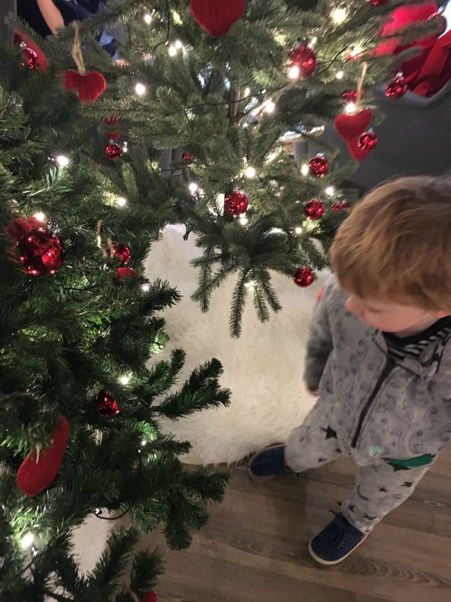 Traffic-Jams-and-Trumpets-toddler-near-christmas-tree-at-ikea