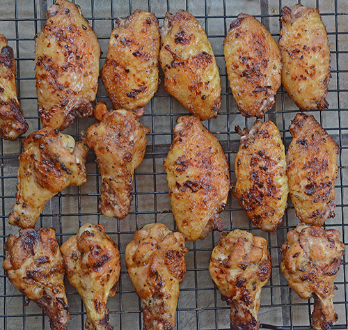 Norris Dam Good White BBQ Sauce Fire Roasted Wings on a ceramic kamado grill.