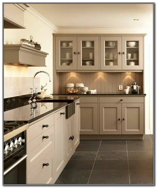 beige kitchen cabinets with black countertops