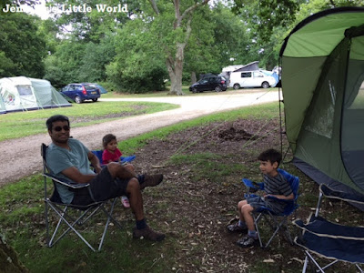 Family sitting outside a tent in the New Forest