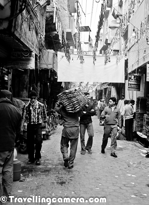 During recent visit to Amritsar City of Punjab, we spent significant time in exploring old part of Amritsar City which was quite interesting. It's almost similar to some of the oldest cities with some main markets and has lead in some of the important businesses running in North India. Let's have a Street Photo Journey to know more about the Old part of Amritsar City..After visiting Golden Temple and Jallianwala Bagh, we thought of visiting Cloth Market of Old Amritsar. Amritsar is a most popular place in North India for Cloth Market. There are lot of cloth factories around the city and most of the cloth in North India is distributed form this place and some of the merchants only deal in export. It was an interesting walk and the lanes inside this market look more like Delhi's Chandni Chowk where lot of businessmen run business of millions in extremely small shopsSome of the havelis in these street were quite old, but still looking good. At times, it's hard to believe that people live in these streets but most of the times people don't want to leave these streets as they have very strong bonding in the social circle there. Mainly it's found that people in such regions of big cities are more social than the ones live in apartments or newer parts of the cities. Amritsar is situated around 220 kilometres northwest of state capital Chandigarh and is 30 kilometres east of Lahore, Pakistan and therefore very close to India's western border with PakistanSomehow I have some bad stories associated with these streets of Amritsar. Approximately 10 years back I was in Amritsar during Holi time and was passing through these streets. By the time I reached my destination, I was completely drenched in colorful water. Children from high buildings were continuously bombarding balloons filled with colorful water :) ... And it was hard to figure out probable dangerous areas :)... Amritsar is a city in the north-western part of India and situated in Punjab State. It is the administrative headquarters of the Amritsar district in the state of Punjab, India. Amritsar is well known as the spiritual center for the Sikh religionSome of the houses in these streets looked quite old but still very well maintained and it seems that most of the business families of Cloth Market are still living in these regions and they like the place like anything.Somehow Cloth Market was closed on 1st day of the year 2012 and only few of the folks were doing some cleaning in there shops. These streets are dedicated to different type of cloth. E.g.- There were some of the streets where only wedding cloths can be found and on the other one only blankets, bedsheets etc. There are few other markets around the cloth market in Amritsar - Jewellery Market, Steel Market etc...Here is one link which talks about some of the main markets in Amritsar City of Punjab - http://www.traveliteindia.com/content/LocalMarketsAmritsar.aspA rickshaw loaded with lot of cloth pieces/bunches.Here is a wonderful which talks about various eating places for Vegetarian and Non-Veg folks, Sweet Shops, Markets like Dry Fruit Market, Hall Bazar and some basic tips about traveling to Amritsar - http://www.traveltoamritsar.com/travel-guide.htmlOne of my friend bought lot of steel stuff for his kitchen and he was in full mood of doing shopping in Amritsar. At least he was happy about the fact that his car fully utilized to take the stuff from Amritsar to Chandigarh :)These were few of the Photographs from Old Amritsar and keep watching this place for more Photo Journeys from Amritsar City of Punjab !