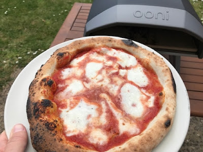 Delicious pizza from the Ooni Koda pizza oven outdoors