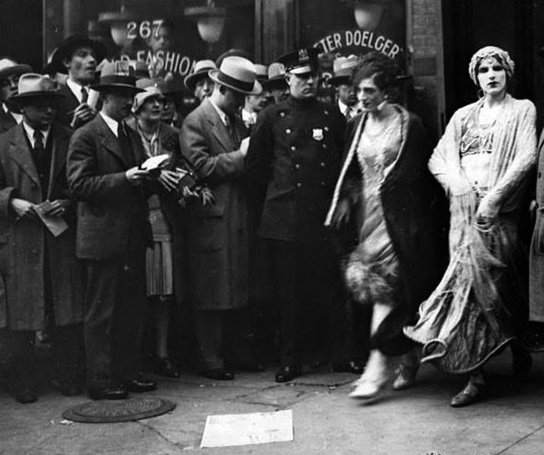 Out and about, two femulators exit the theater presenting Mae West's play The Pleasure Man after the police shut it down, October 2, 1928.