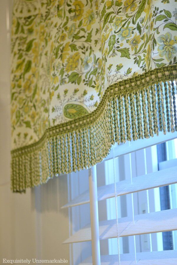 Green Paisley Valance With Fringe Trim on white trim window