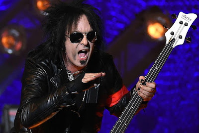 Nikki Sixx  enjoying in a concert with his band