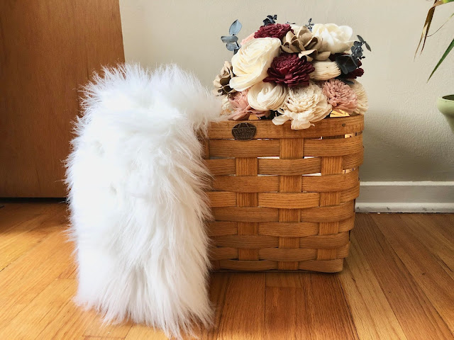 peterboro basket used to store decor and throws