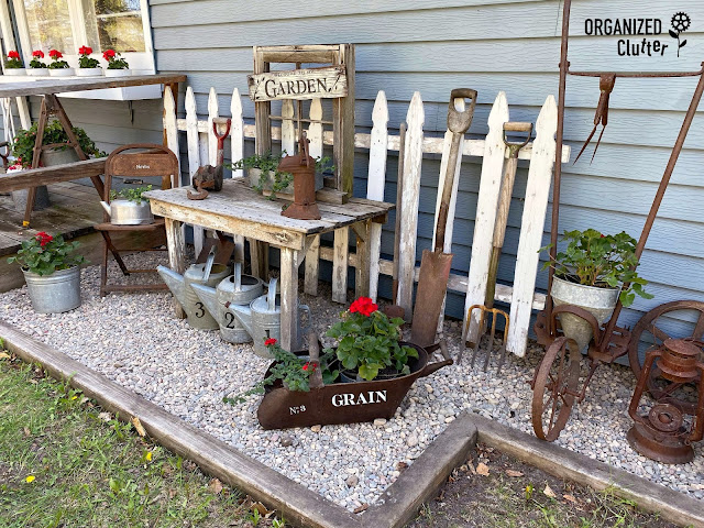 Photo of side yard junk garden decor and plants