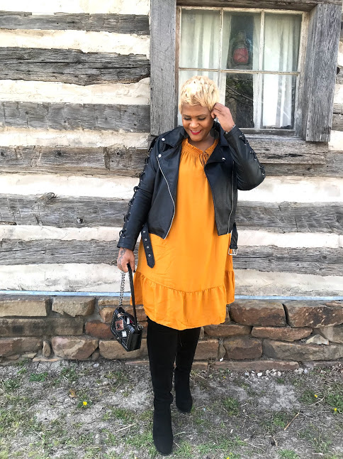 Tangie Bell sharing how she re-wears her clothes. Yellow dress , over the knee boots and black faux jacket.
