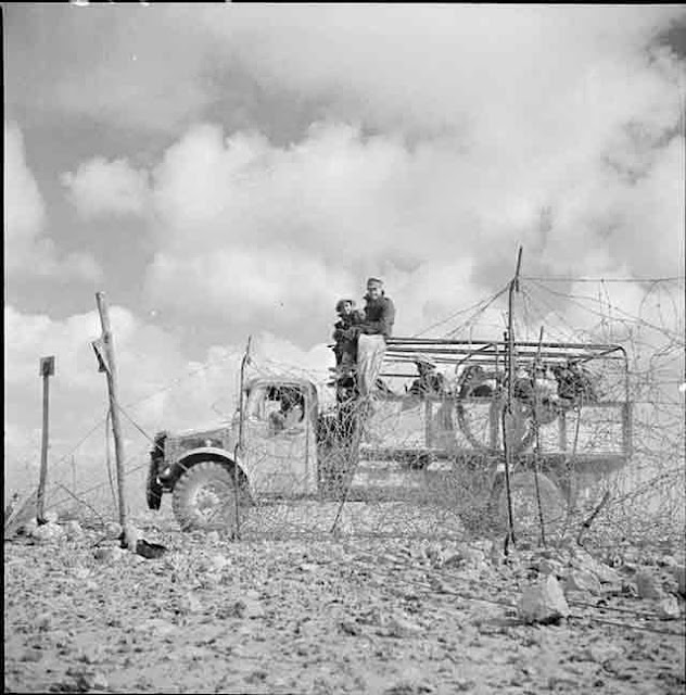 "A British Bedford ""crossing the wire"" into Libya, 22 November 1941 worldwartwo.filminspector.com"