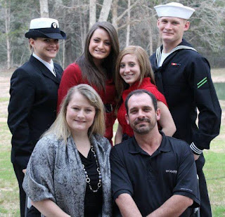 Laynee (back row, second from left) and her family. Her brother and sister are also proudly serving in the military.
