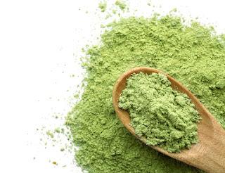 Green Powder on Wooden Spoon