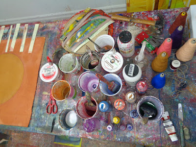 mixed media abstract paintings circles and lines showing studio tools