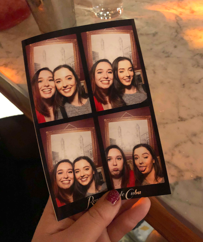 Four photo booth pictures of two girls posing