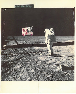 Photo of astronaut on Moon with flag