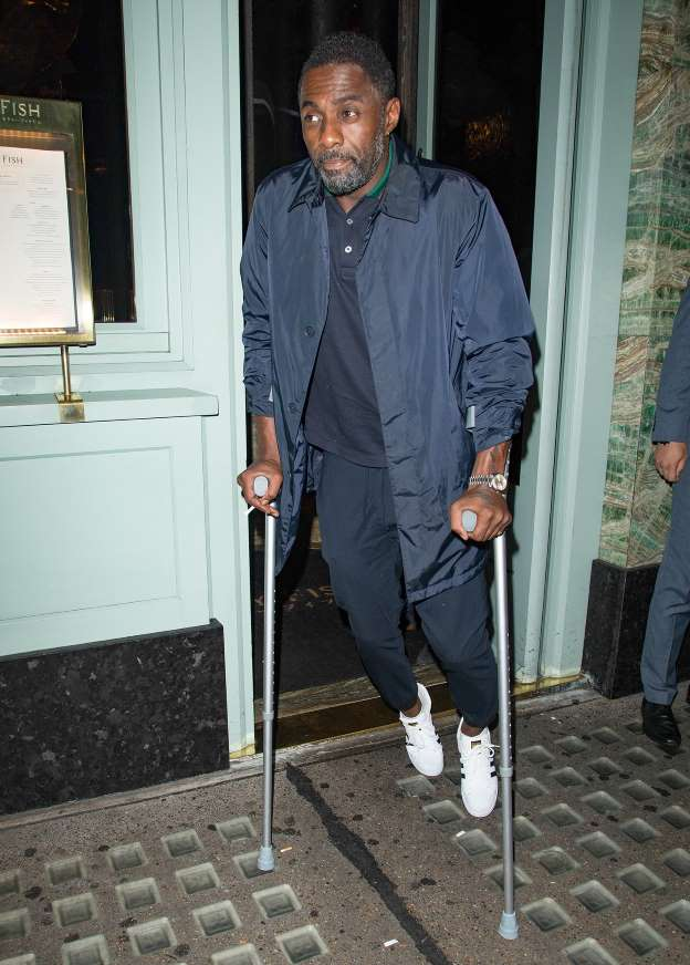 Idris Elba Hobbles Out of London Restaurant on Crutches After Injuring His Knee