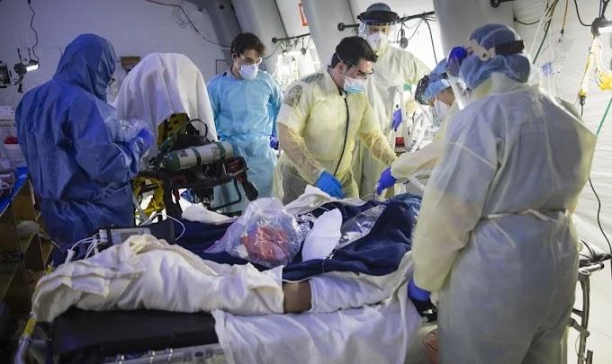 Pacientes com Covid-19 recebem cuidados médicos e orações em hospital de campanha, nos EUA