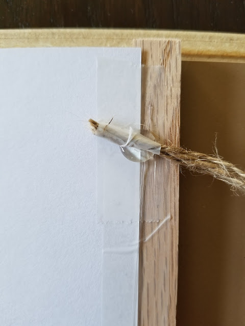 attaching twine to a DIY hanging frame