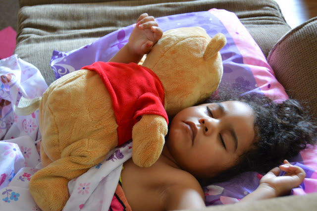 Sofia taking a nap with her stuffed Winnie the Pooh