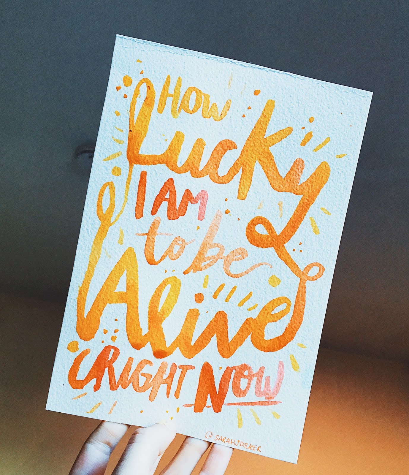 Orange and yellow hand lettering