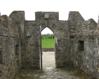 Outward view through an arched doorway, Doe Castle, Sheephaven Bay, County Donegal, Ireland