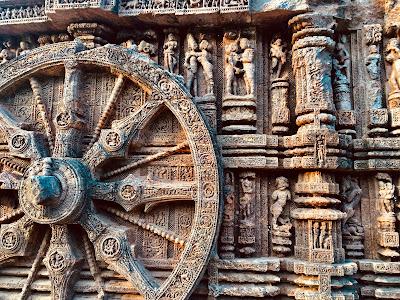 konark sun temple,stone chariot,stone wheel,erotic scupture