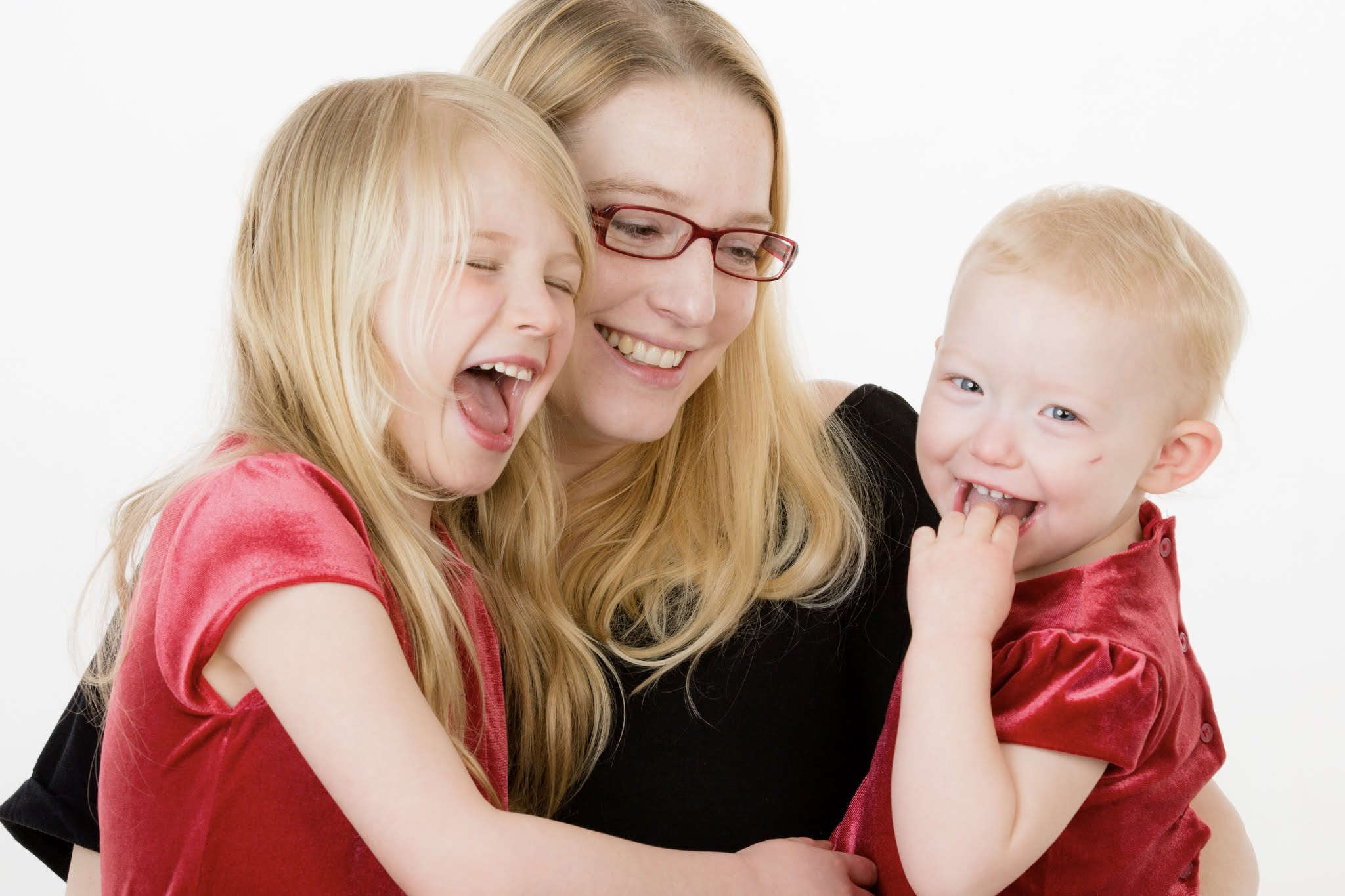 A professional image of me and my 2 daughters. My younger daughter has a healing cut visible on her face