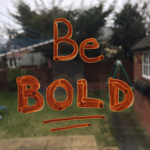 Be Bold typography on window using chalk markers